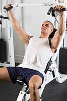 Hispanic man exercising in gym