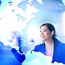 Asian businesswoman pointing to world map