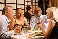 Multi_ethnic couples eating at restaurant