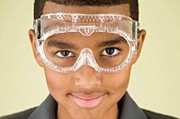 Mixed Race boy wearing protective eyewear