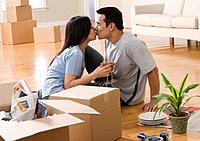Asian couple kissing in new house