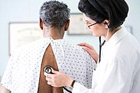 Middle Eastern female doctor examining patient
