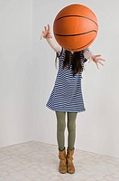 A girl throwing a basket ball