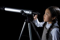 A girl with a telescope