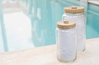 Jars by swimming pool
