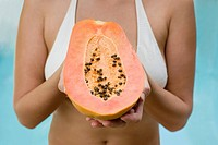 Woman holding papaya