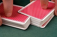 Person shuffling playing cards