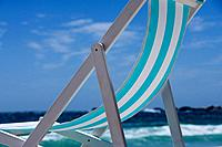 Deck chair on beach, low angle view (thumbnail)