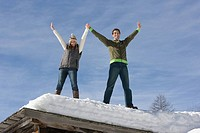 A couple standing on a roof