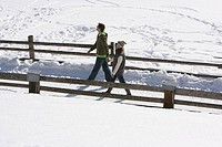 A couple walking through snow