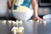Woman with popcorn in kitchen