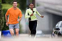 Young couple running outdoors