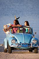 Young surfers in convertible car