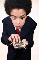 A boy using a calculator (thumbnail)