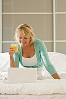 Woman on bed with laptop