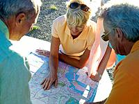 Couples looking at road map, close-up