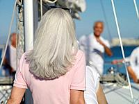 Senior woman on yacht, rear view