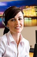 Receptionist with headset, smiling, portrait