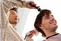 Hairdresser drying client´s hair