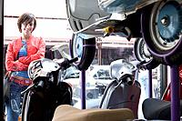 Woman looking at scooters in shop