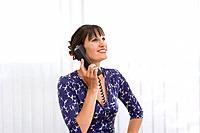 Woman on telephone, smiling