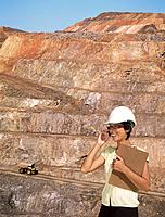 Mixed race businesswoman working at mine site