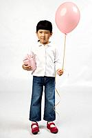 Korean girl holding balloon and birthday present