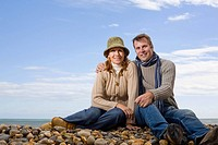 Couple on a pebble beach