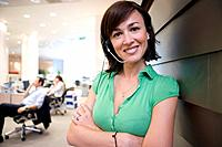 Businesswoman with headset, smiling, portrait