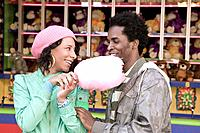 African couple eating cotton candy