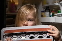 Girl holding egg carton