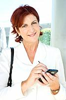 Businesswoman with electronic organiser, portrait, close-up