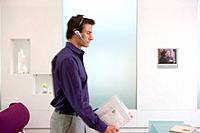Businessman with headset in office blurred motion