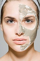 Woman with face mask on half of her face