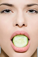 Woman with cucumber in her mouth
