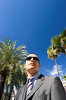 Businessman outdoors in sunglasses