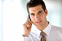 Businessman talking on cell phone