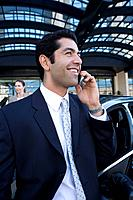 Businessman talking on cell phone in urban setting