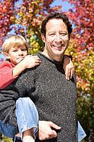 Father giving son a piggyback ride