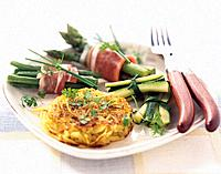 Potato paillasson with bundles of green vegetables