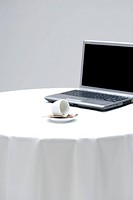 Coffee cup with laptop
