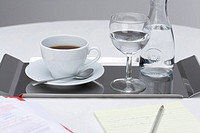 Coffee cup with water on tray
