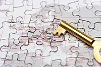 Key on Jigsaw Puzzle, close_up