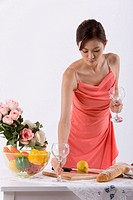 Young woman setting table, close_up