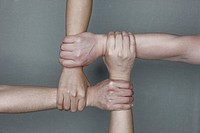Human hands holding together in lattice formation