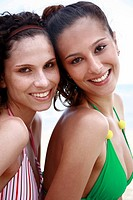 Closeup of two female young adults posing in bikinis