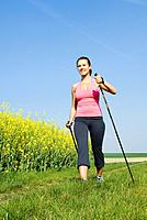 young woman nordic walking