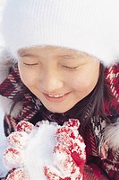 Korean Girl Smiling with Snowball