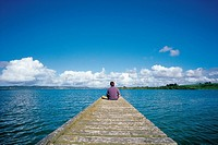 Man Sitting on the Dock,North Island,New Zealand