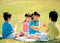 Korean Kids Playing in the Green Field